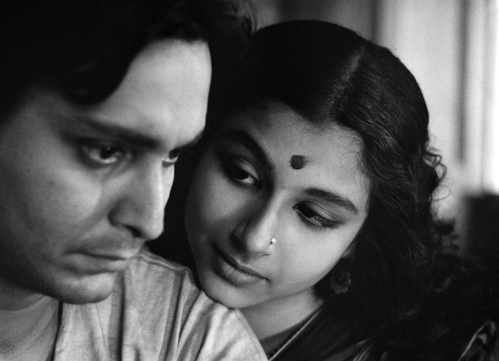 Aparna (Sharmila Tagore) and Apu (Soumitra Chatterjee) in Calcutta. Apur Sansar (The World of Apu). The final film of The Apu Trilogy