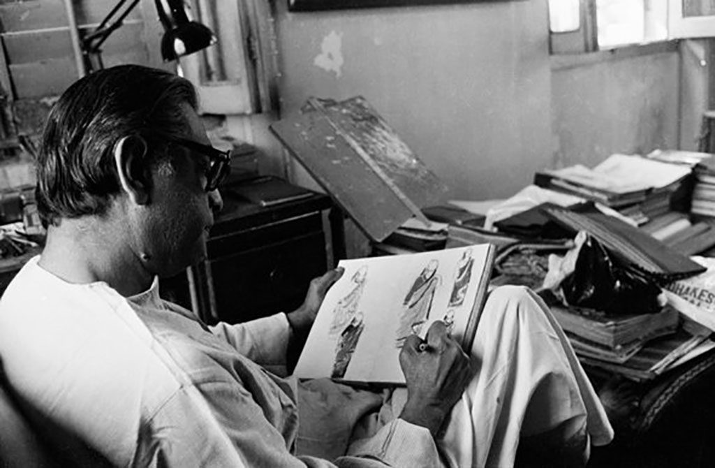 Satyajit Ray sketching costumes possibly for home and the world 1984 ©Nemai Ghosh