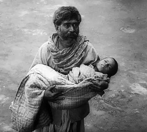 A villager brings a dying child for Devi's blessings