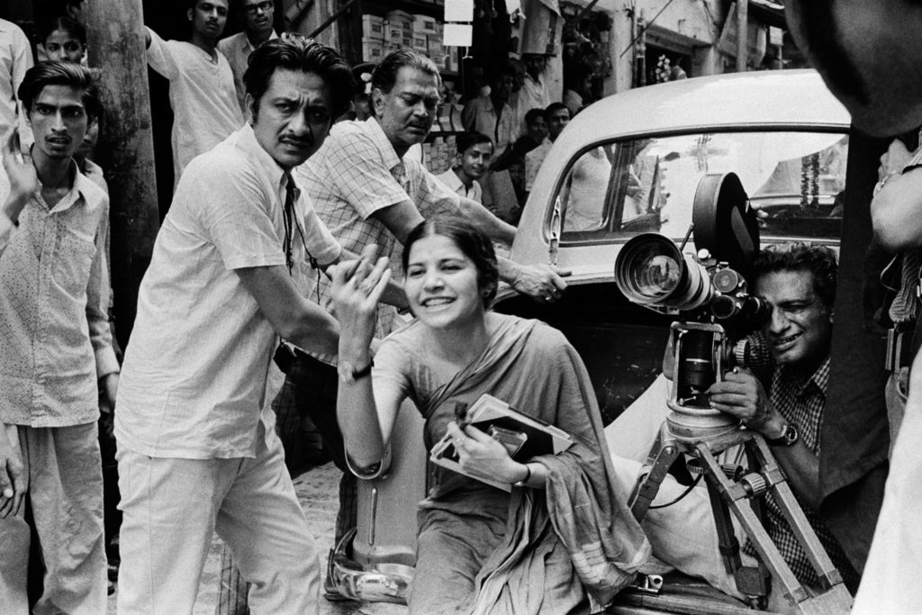 Ray behind the camera with crew and assistant director Suhasini Mulay on location for The Middleman (1975) ©Nemai Ghosh