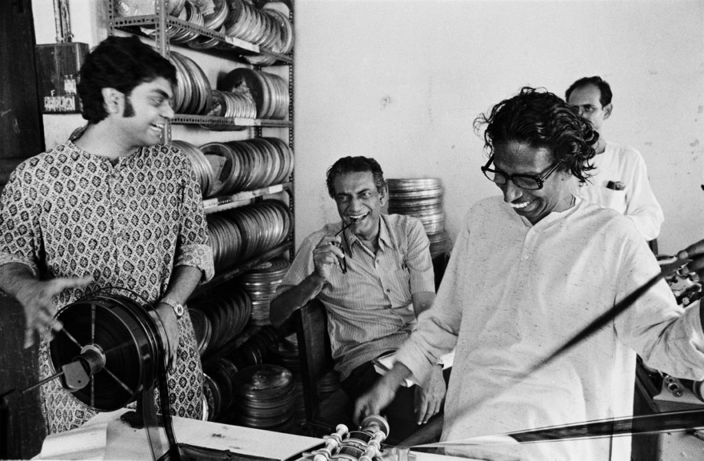 Satyajit Ray with his son, editing THE CHESS PLAYERS. Photo by Pablo Bartholomew, 1978